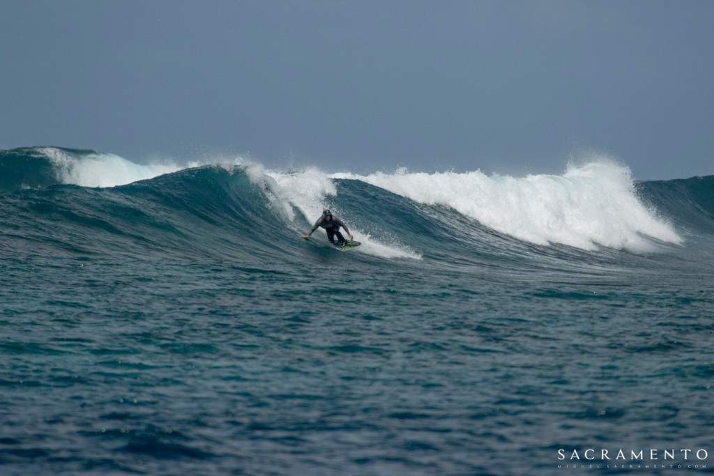Tom Curren riding a skimboard in the Maldives on a LUEX boat trip